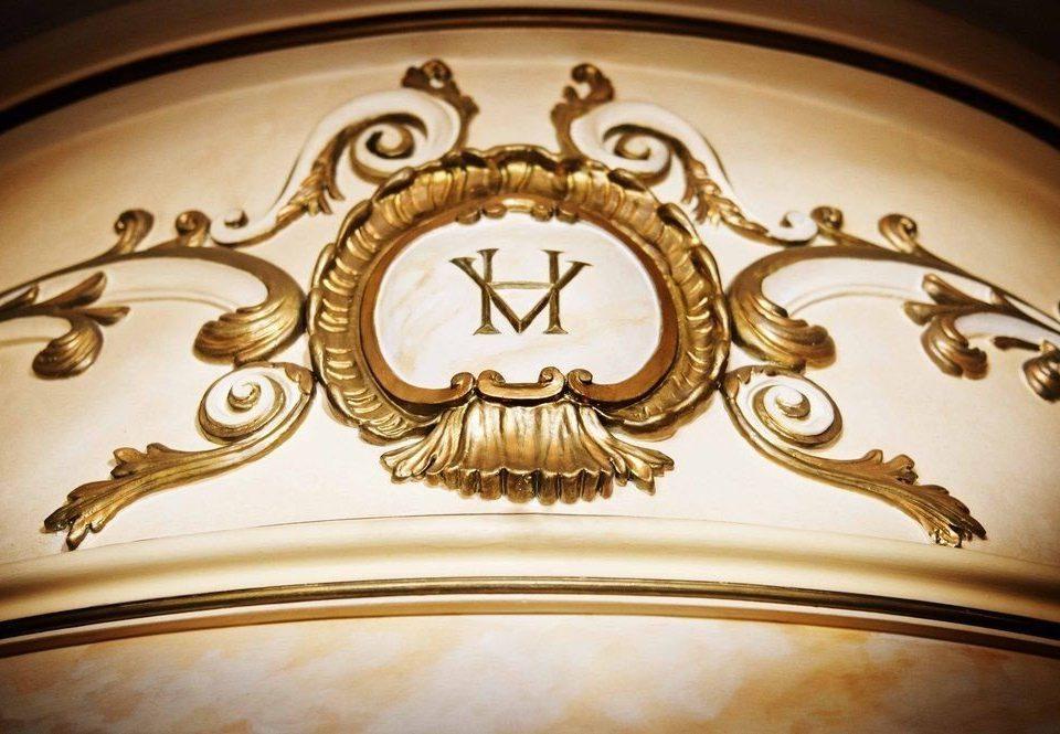 carving lighting gold circle ancient history metal material close