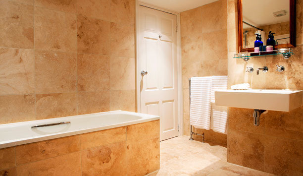 bathroom property tile home flooring bathroom cabinet angle hardwood plumbing fixture wood flooring tub bathtub tan
