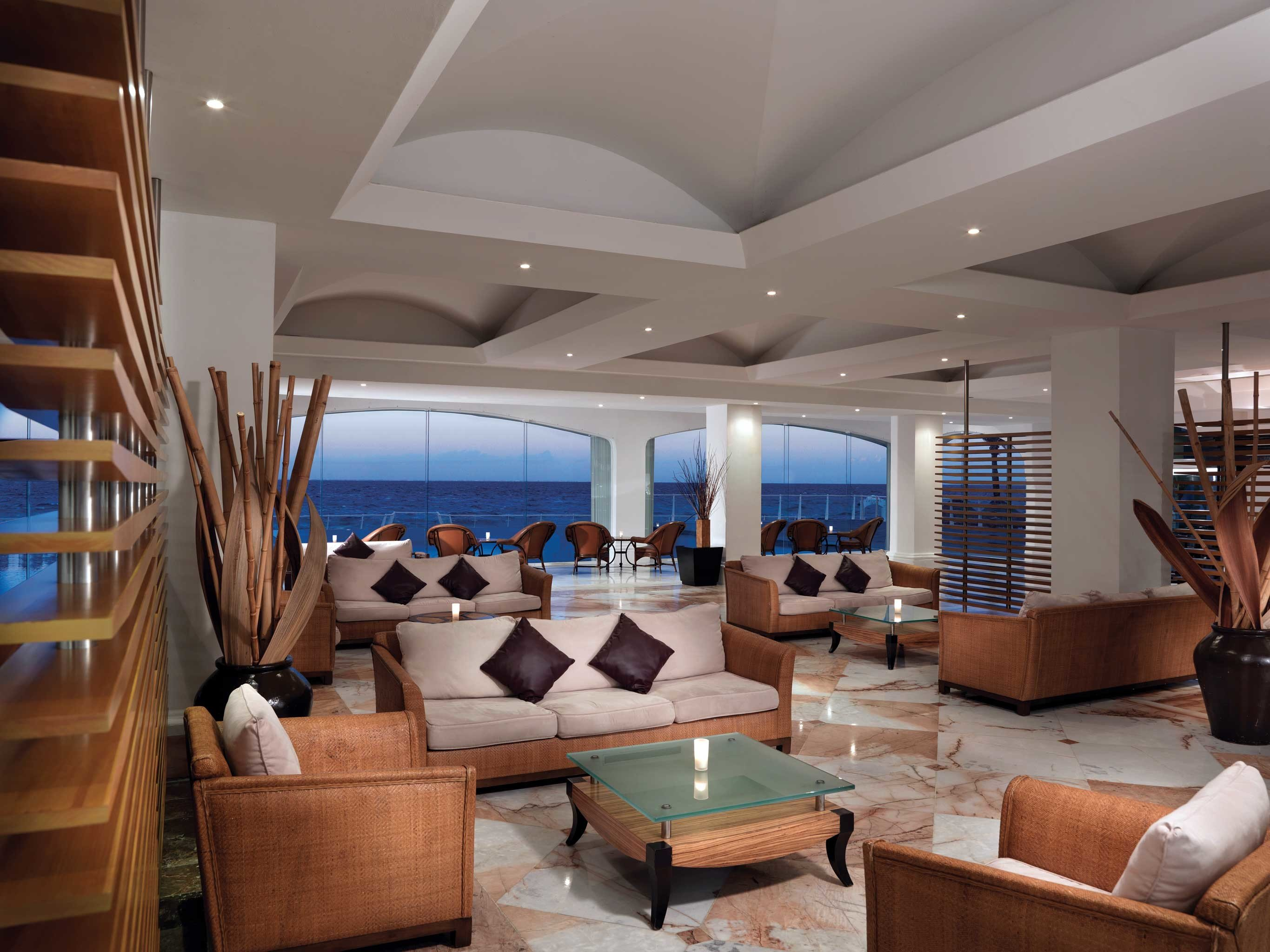 All-inclusive Beachfront Hotels Lounge Luxury Romance Scenic views indoor ceiling room floor property chair Living Lobby living room Boat estate yacht condominium passenger ship interior design Resort furniture home real estate ship luxury yacht several