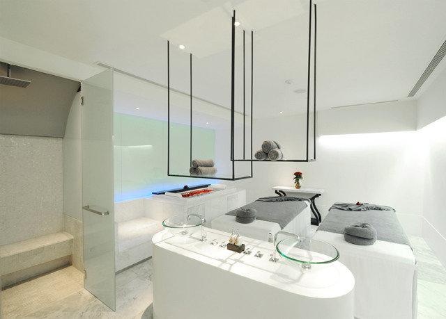 property white bathroom home bidet lighting bathtub plumbing fixture appliance