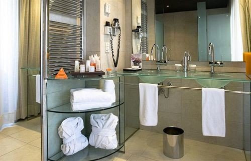 bathroom property sink home countertop plumbing fixture flooring toilet appliance