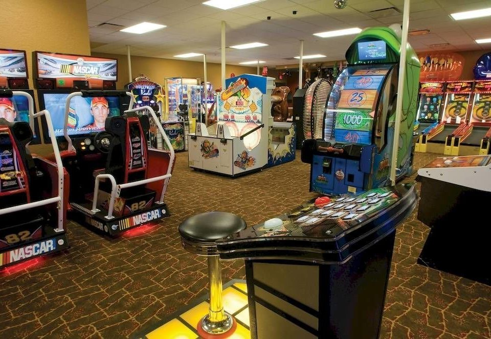 games desk machine arcade game recreation room recreation technology cluttered