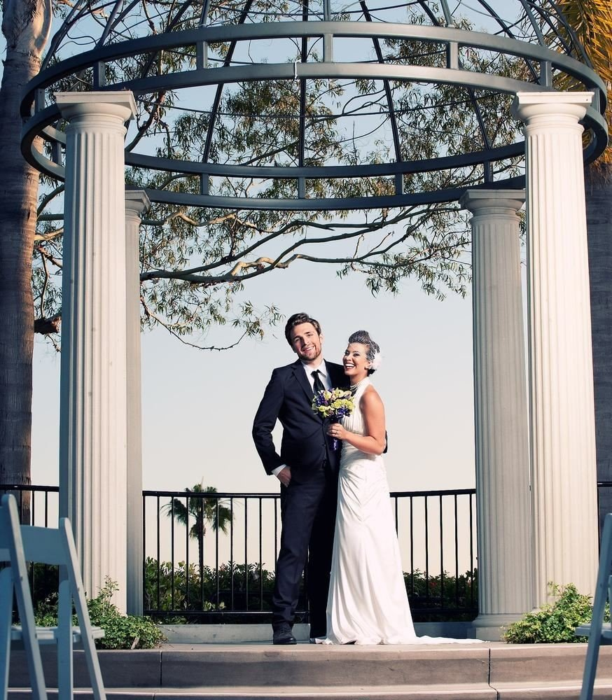 building photograph woman bride man wedding groom ceremony event gown porch arch colonnade