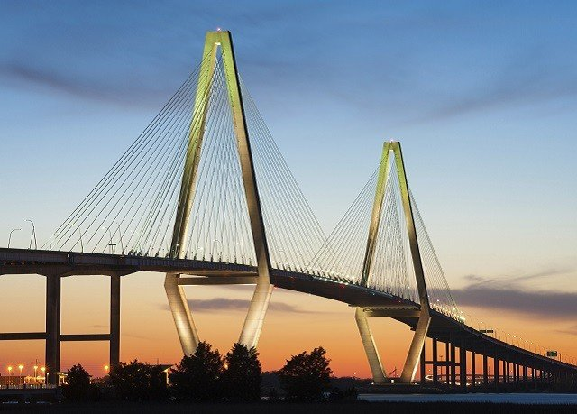 sky cable stayed bridge bridge water landmark nonbuilding structure background arch bridge distance
