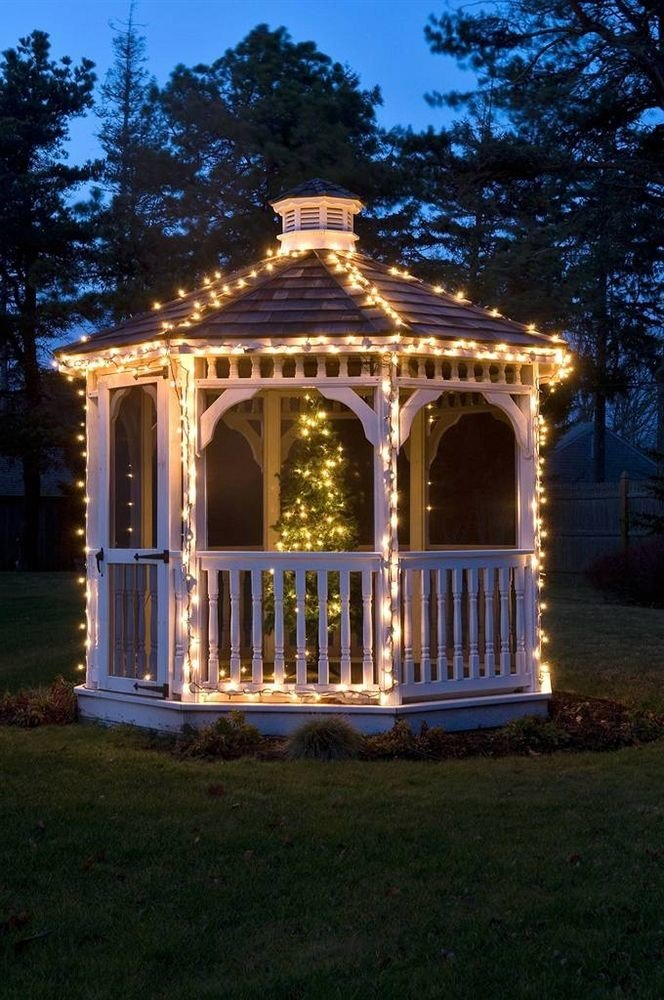 grass tree building gazebo house night lighting outdoor structure landscape lighting mansion home porch arch