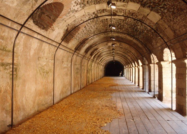 building tunnel Architecture stone arch arcade infrastructure symmetry ancient history aisle subway crypt metro station walkway court colonnade