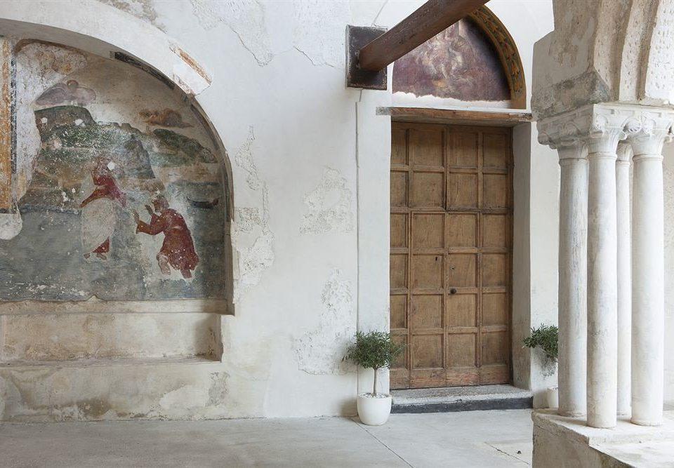 building Architecture house stone art ancient history door arch chapel temple step concrete cement colonnade