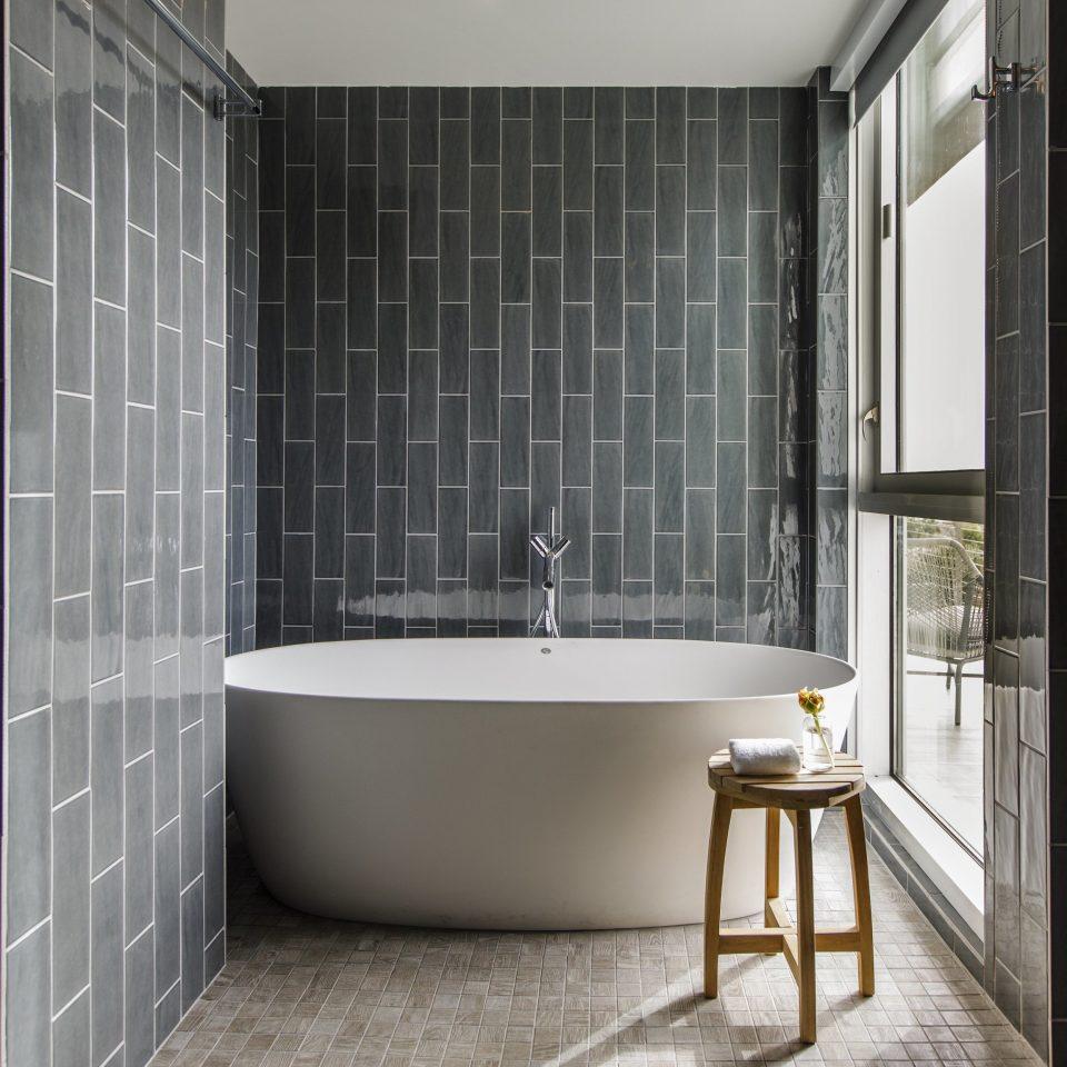 bathroom tiled Architecture bathroom accessory tile white plumbing fixture flooring angle bathroom cabinet glass toilet tub bathtub