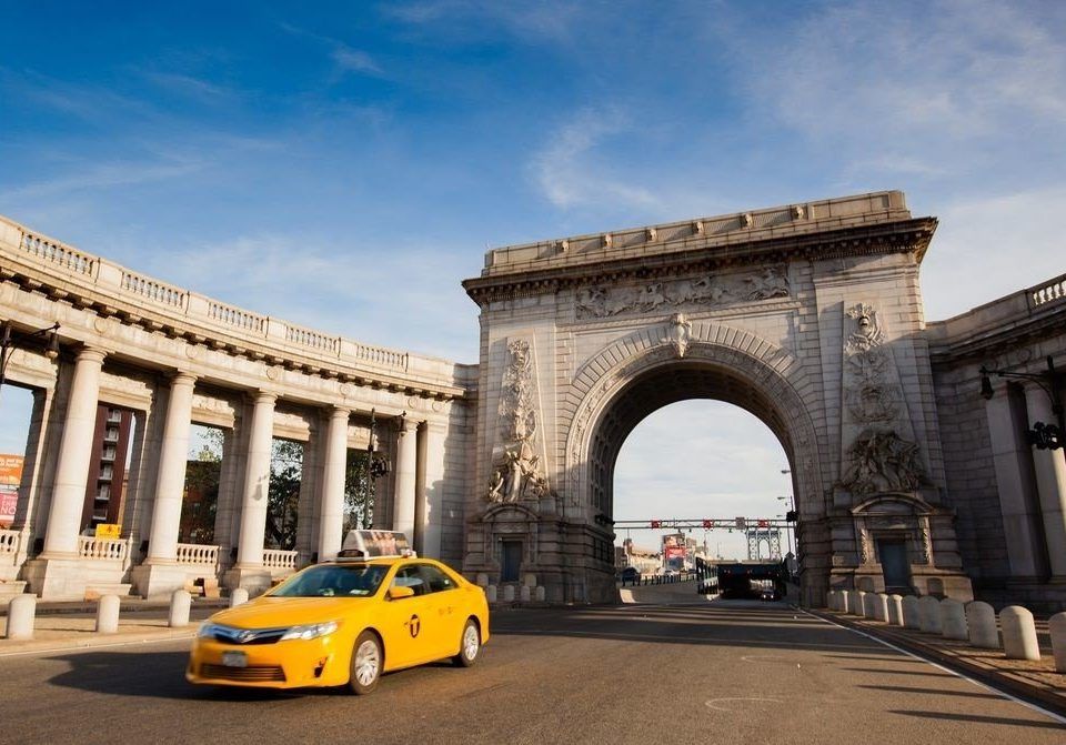 sky building road yellow structure transport landmark Architecture arch vehicle stone colonnade