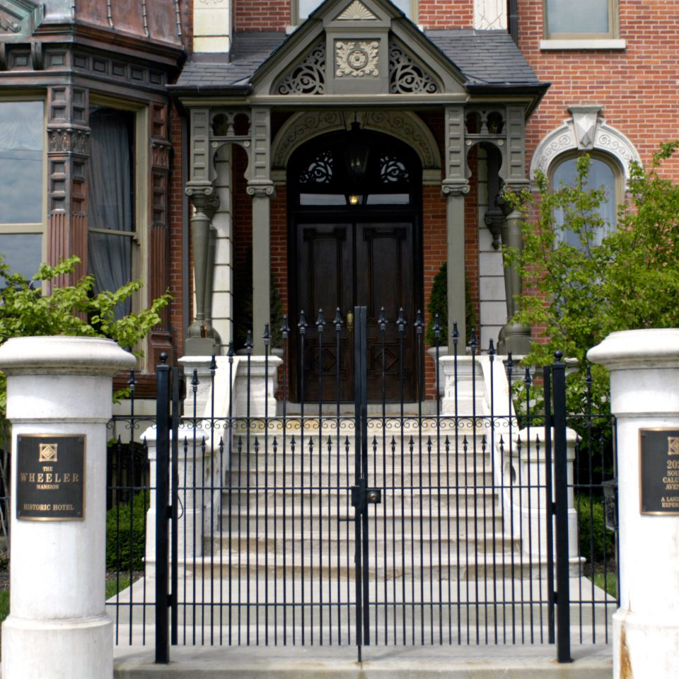 Architecture B&B Buildings Cultural Eat Grounds Landmarks Museums Nightlife building gate sidewalk home porch outdoor structure door walkway