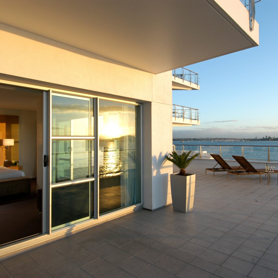 Balcony Bedroom Boutique Hotels Festivals + Events Hotels Patio Resort Scenic views Trip Ideas Waterfront property building house condominium Architecture home Villa daylighting professional porch