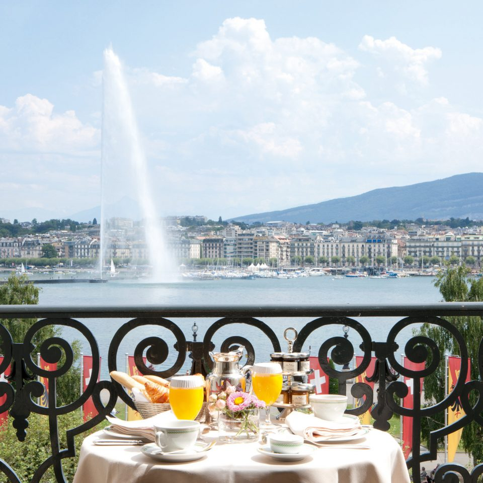 Architecture Balcony City Courtyard Dining Drink Eat Elegant Historic Luxury Patio Scenic views Terrace Waterfront sky water mountain Lake