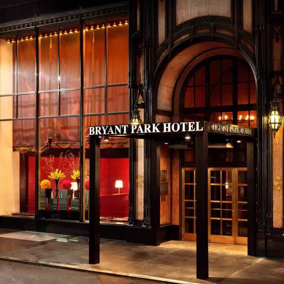 Architecture Buildings Exterior building night retail lighting restaurant display window Bar way