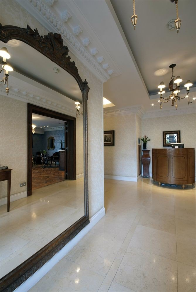 Lobby property building Architecture lighting home flooring hall living room Bath tiled