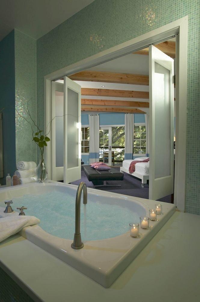 Luxury Romantic Spa bathroom sink property house swimming pool Architecture counter condominium living room home daylighting professional Bath