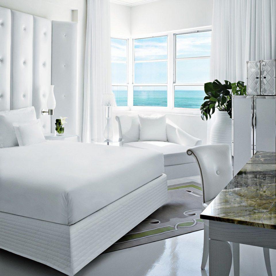 Architecture Beach Beachfront City Elegant Hip Honeymoon Hotels Landmarks Luxury Nightlife Party Pool Resort Romance Shop Waterfront white living room bed frame Bedroom bed sheet