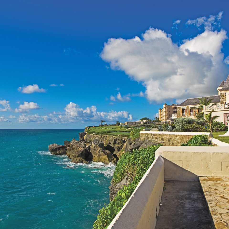 Architecture Beachfront Buildings Exterior Grounds Resort Scenic views sky Coast Sea shore Ocean Nature cape caribbean cliff terrain Beach stone day
