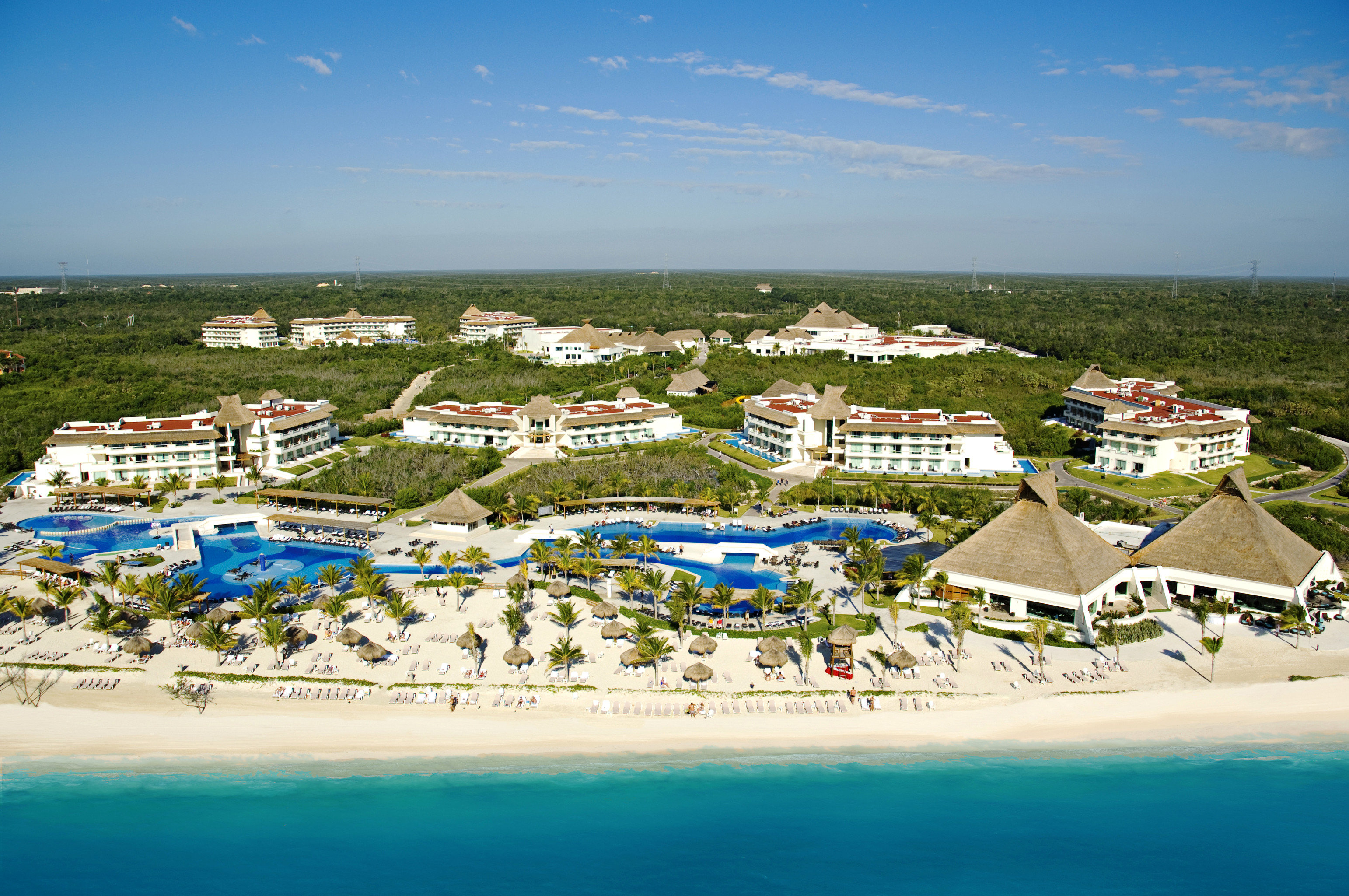 Architecture Beach Beachfront Buildings Exterior Grounds Lounge Luxury Ocean sky water Sea Nature Coast shore caribbean Island aerial photography Resort cape lined sandy
