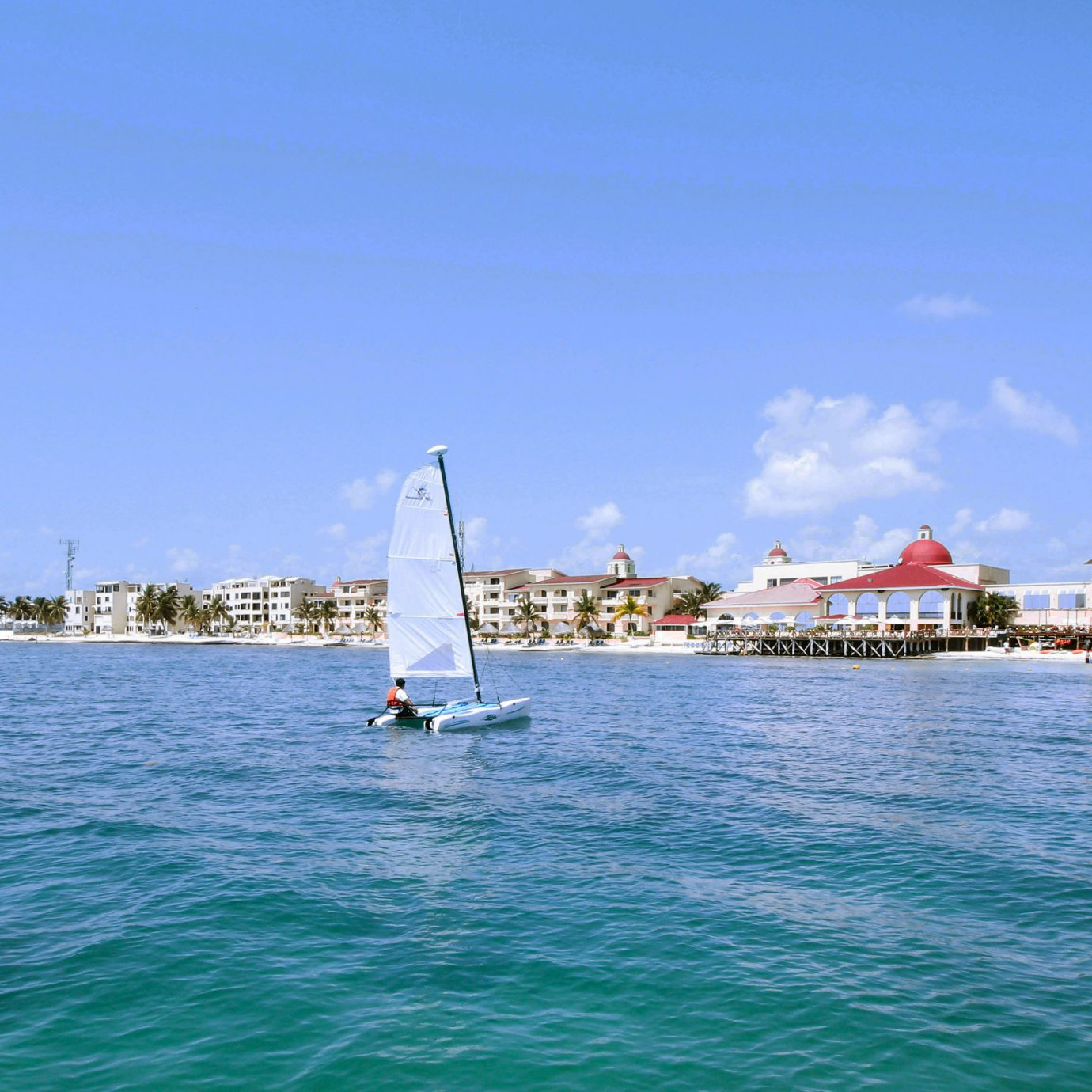 Architecture Beach Boat Exterior Ocean water sky watercraft vehicle transport Sea sailboat sailing vessel channel sail marina sailing boating day distance