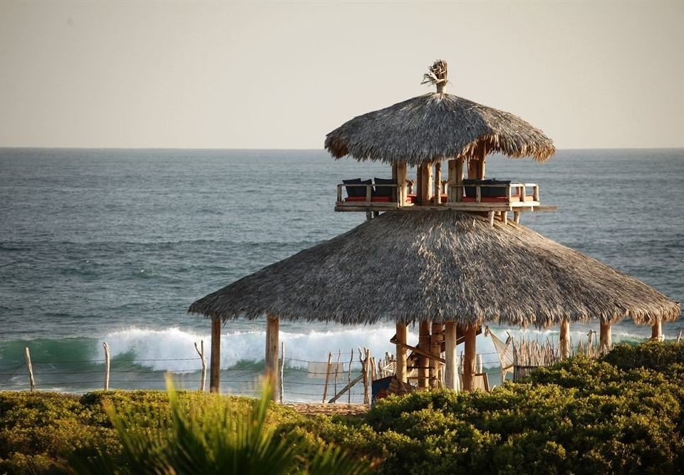 Architecture Buildings Country Elegant Exterior Rustic water sky Sea Ocean Beach shore Coast Nature Resort hut roof Island