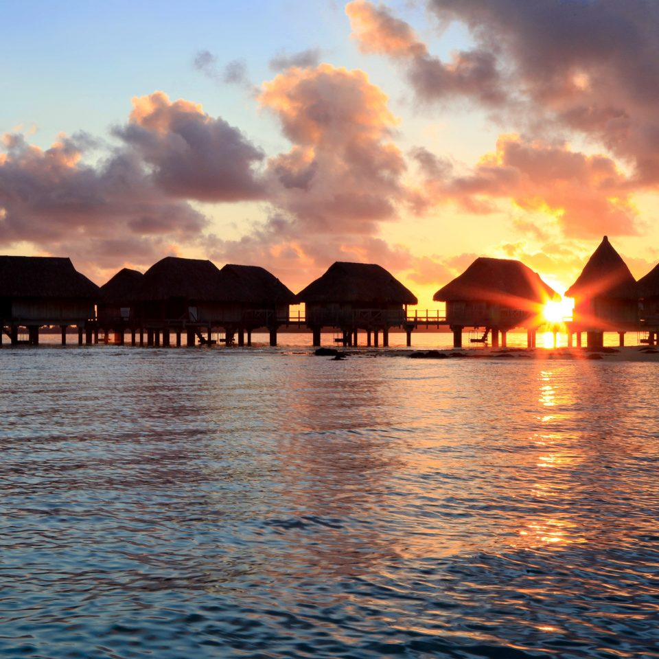 Architecture Buildings Hotels Overwater Bungalow Resort Scenic views Sunset water sky Sea horizon Ocean dusk Coast sunrise evening Beach dawn sunlight cape clouds shore day