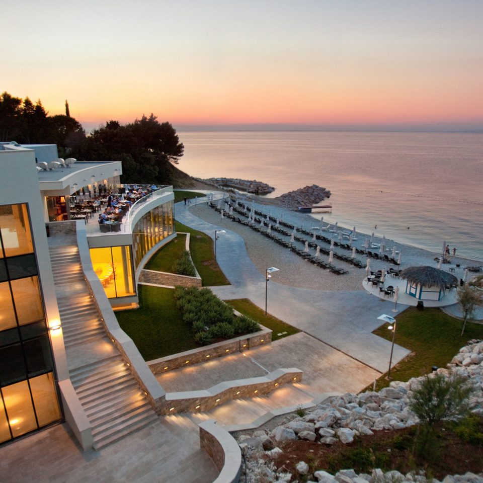 Architecture Buildings Exterior Ocean Scenic views Sea Sunset sky water Nature Coast Resort Beach shore