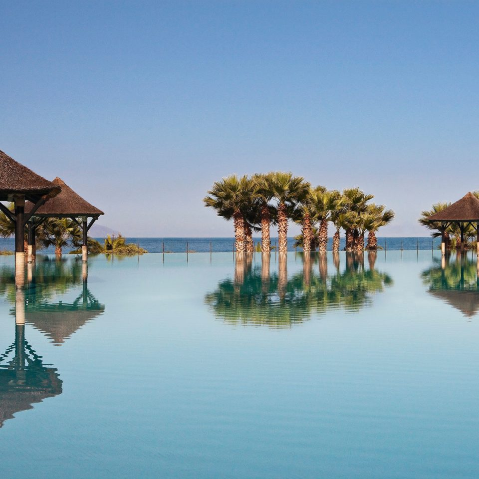 Architecture Buildings Exterior Hip Modern Waterfront water Beach Resort Sea Lagoon swimming pool shore lined surrounded swimming Island