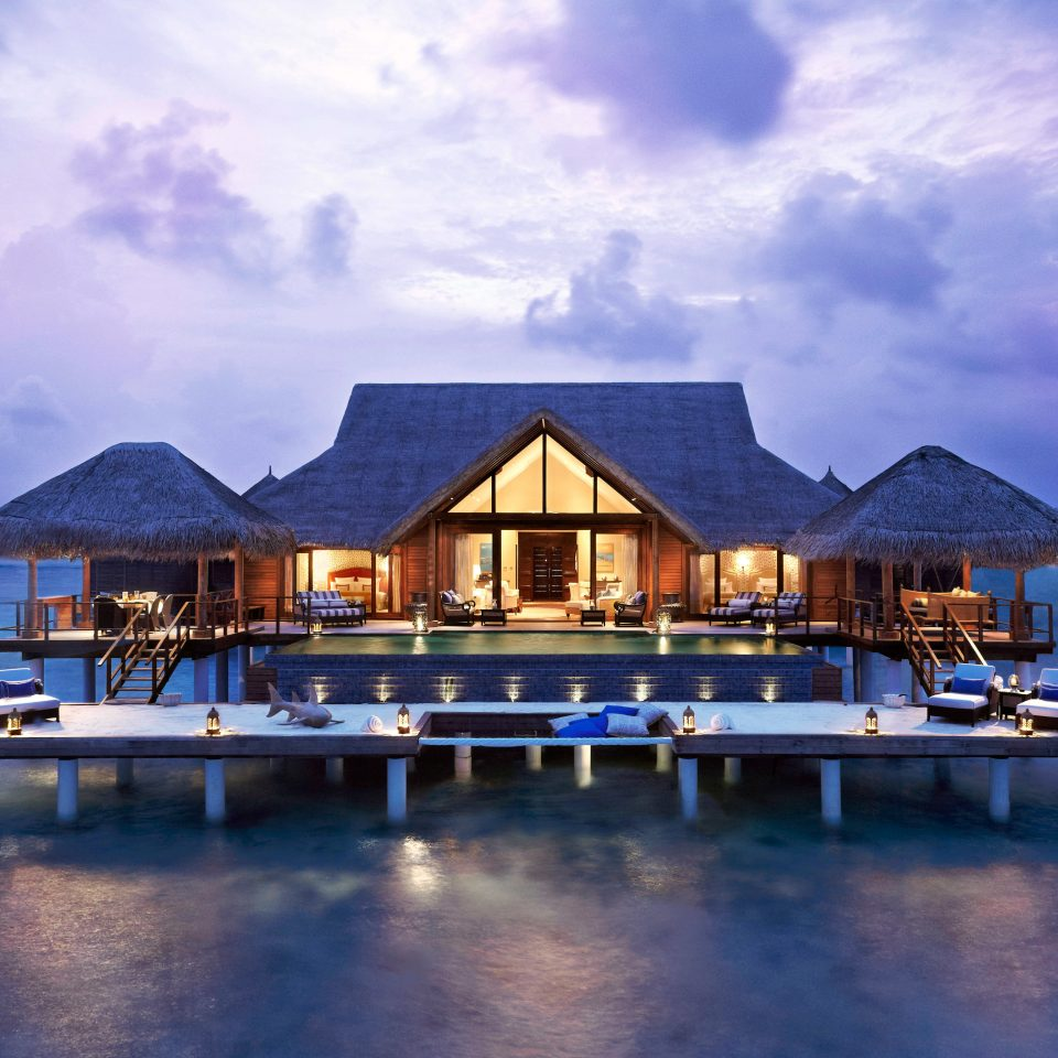 Architecture Beachfront Buildings Exterior Resort Scenic views sky water blue Sea Ocean house horizon evening dusk dock caribbean Coast Lagoon marina Harbor Island