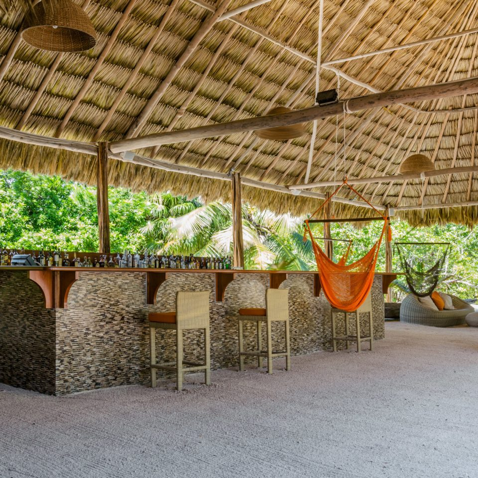 Beachfront Dining Drink Eat Resort Architecture Courtyard hacienda backyard outdoor structure