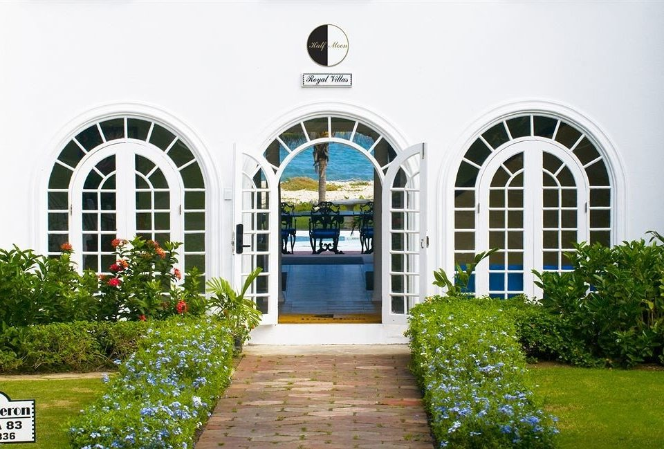 Beachfront Dining Eat Exterior Garden Grounds Pool Tropical Villa grass property building home Architecture green arch Courtyard mansion residential area hacienda cottage orangery stone walkway