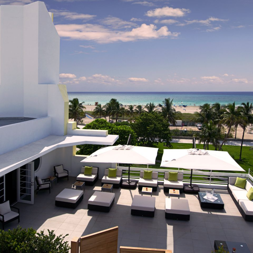Beachfront Deck Ocean Patio sky property Architecture yacht Villa vehicle Resort marina luxury yacht condominium