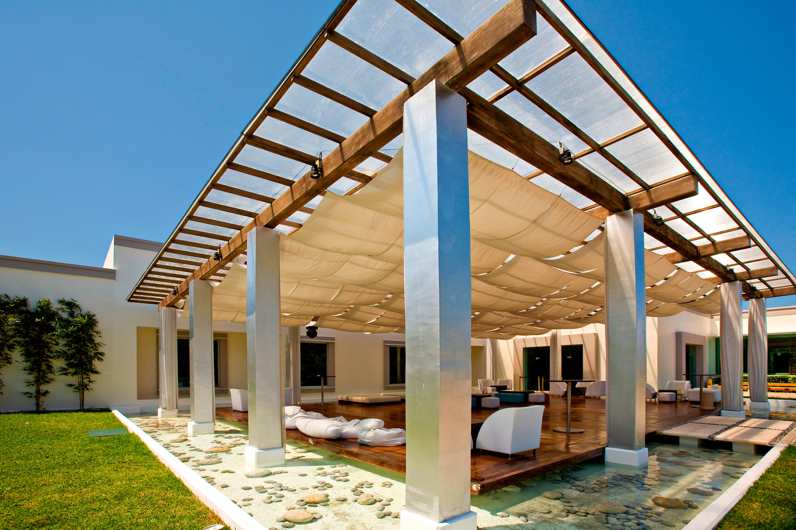 Beachfront Elegant Hip Lounge Luxury sky building pergola property Architecture outdoor structure home daylighting canopy pavilion roof