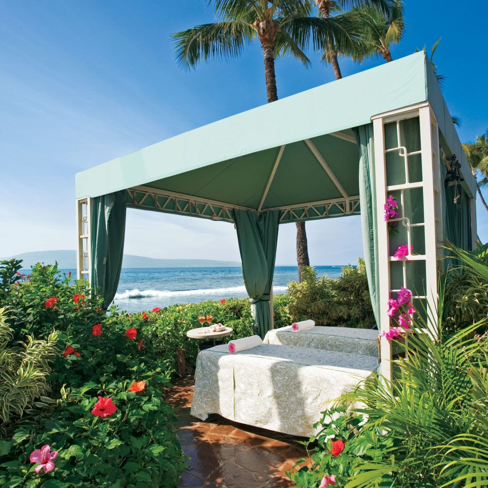 Beachfront Romantic Spa tree sky plant flower Garden walkway house Architecture Resort home Villa arecales bushes cottage porch palm colorful