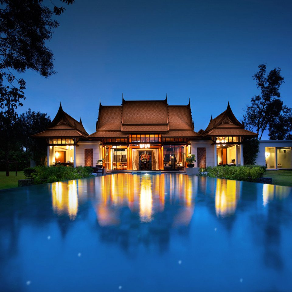 Beachfront Grounds Luxury Pool Romance Romantic water sky house Nature night home Architecture pond evening mansion lighting swimming pool landscape lighting sunlight Resort dusk surrounded