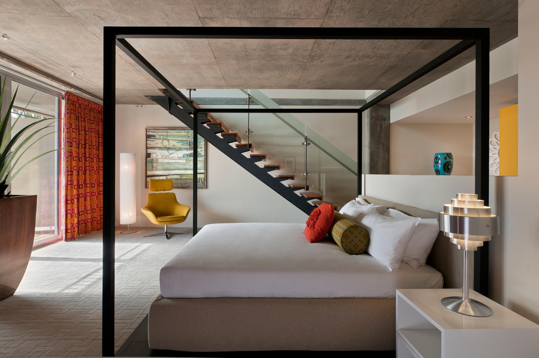 Bedroom Hip Jetsetter Guides Luxury Modern Suite property Architecture living room loft condominium