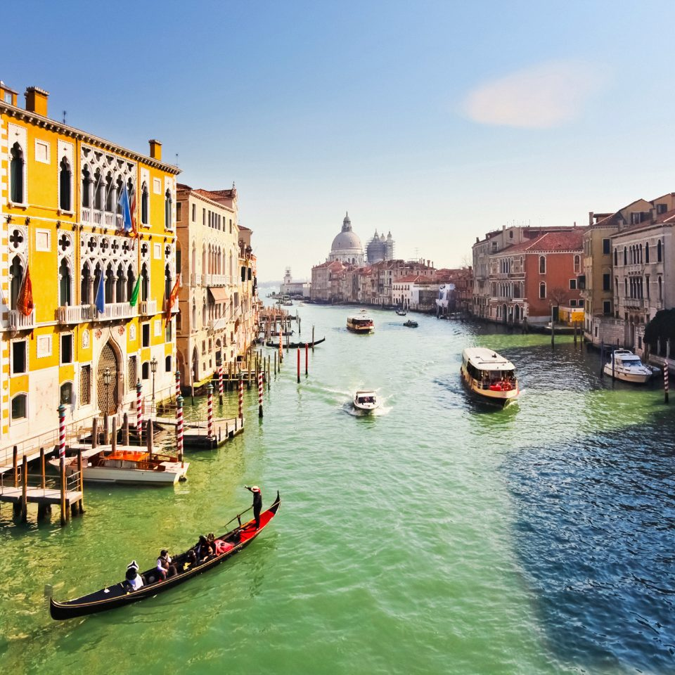 Architecture Buildings City Entertainment Landmarks Monuments Romance Romantic Scenic views sky water Boat Canal vehicle scene River waterway Town gondola channel Harbor watercraft Sea boating cityscape traveling