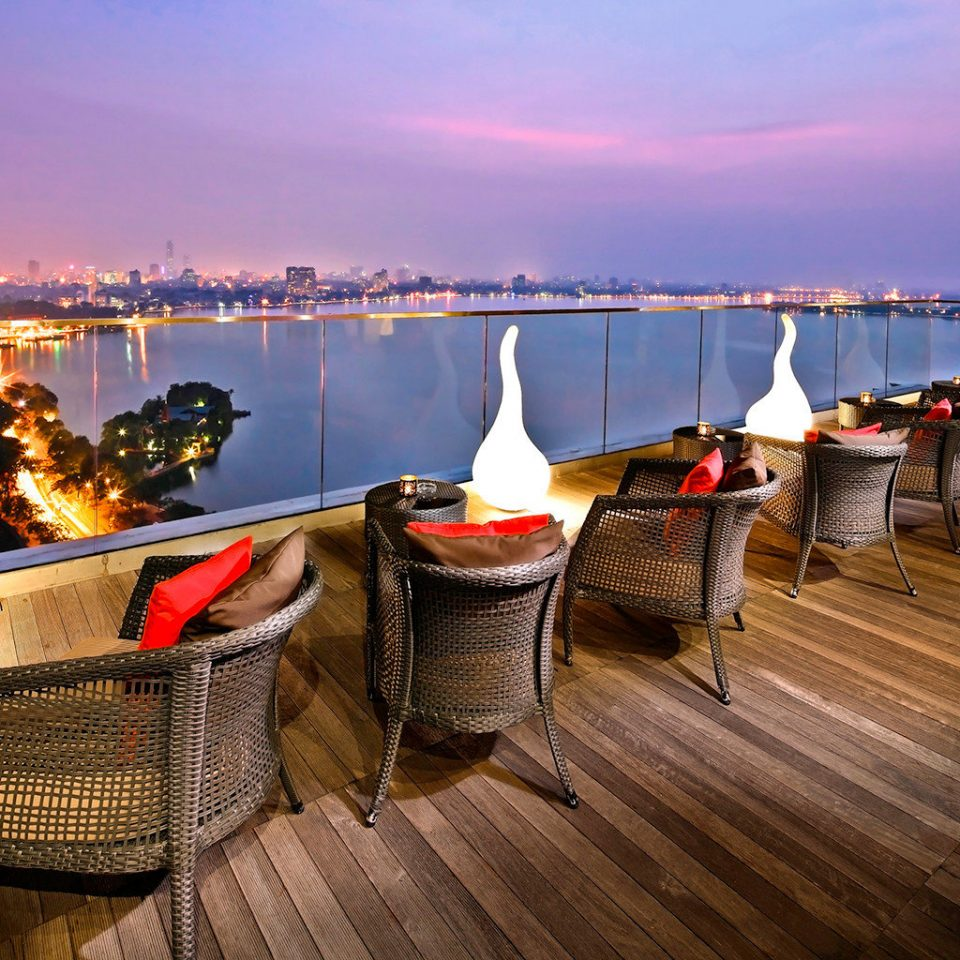 Architecture Buildings City Lounge Nightlife Outdoors Patio Resort Rooftop Scenic views Waterfront sky water night vehicle evening dock Boat tied
