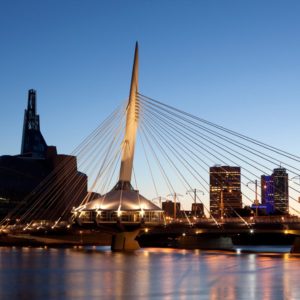 Architecture Buildings City Drink Eat Exterior Shop Waterfront sky water Boat landmark bridge cable stayed bridge skyline cityscape skyscraper evening dusk Harbor vehicle