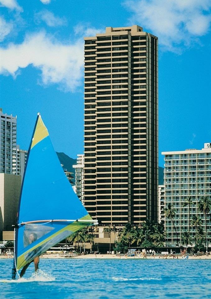 Architecture Boat Buildings Exterior Outdoor Activities Resort sky water skyscraper landmark tower block condominium dock marina skyline sail vehicle sailboat blue cityscape
