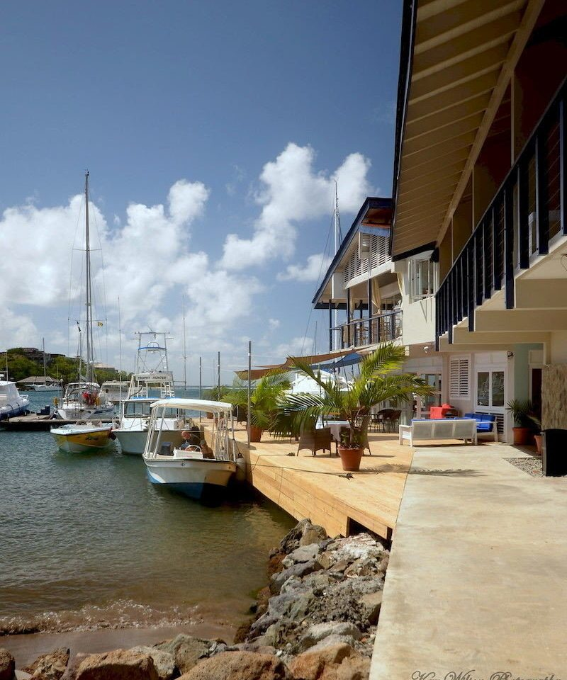 Exterior Waterfront sky Boat Town Architecture dock Sea vehicle marina waterway Coast travel docked day