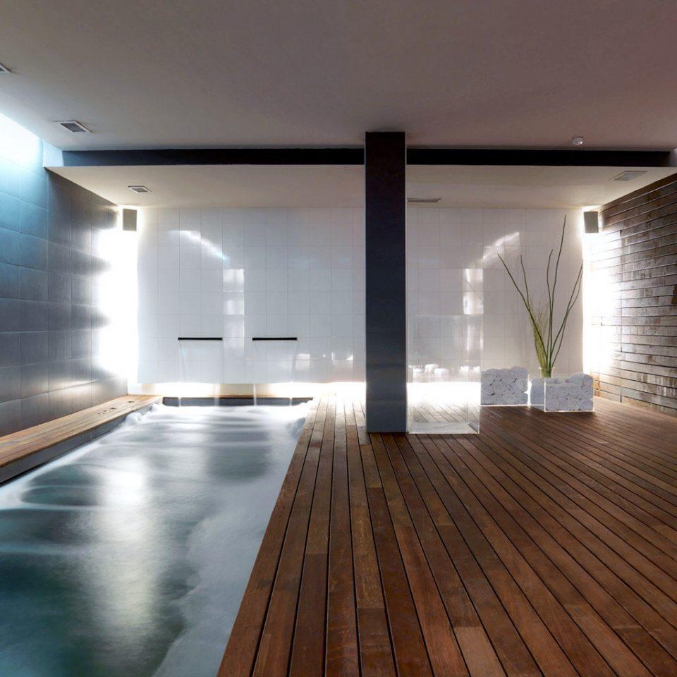 Boutique Budget City Hip Modern Pool Spa property Architecture hardwood flooring lighting professional daylighting swimming pool wood flooring Lobby living room loft