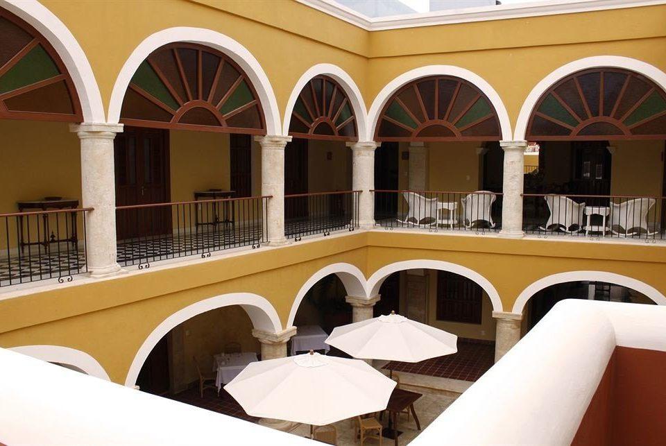 Boutique Budget Courtyard Tropical building Architecture restaurant colonnade arch