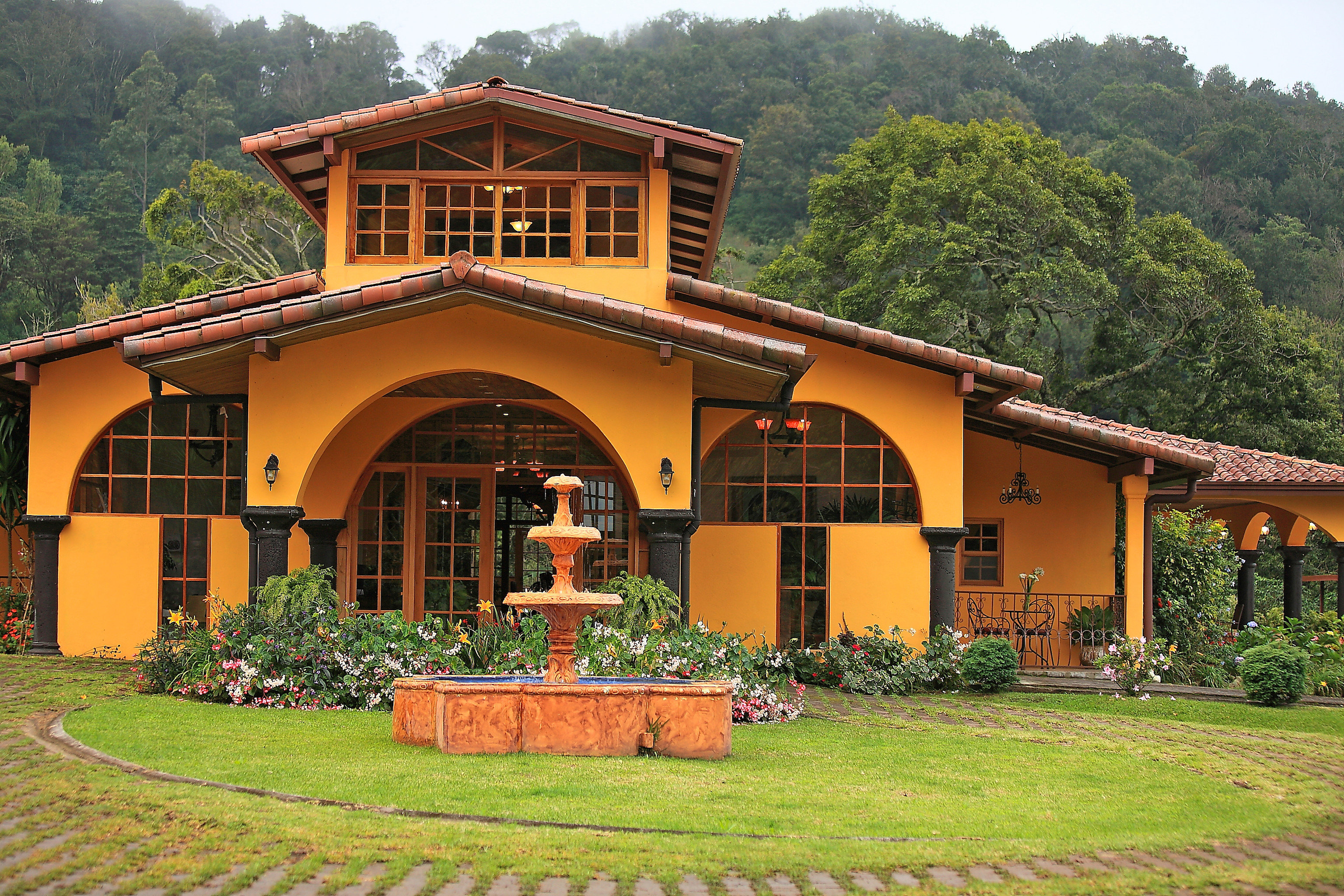 Architecture Boutique Buildings Exterior Grounds Scenic views grass tree building house property home log cabin residential area rural area cottage yellow farmhouse Villa mansion Resort hacienda Garden lush