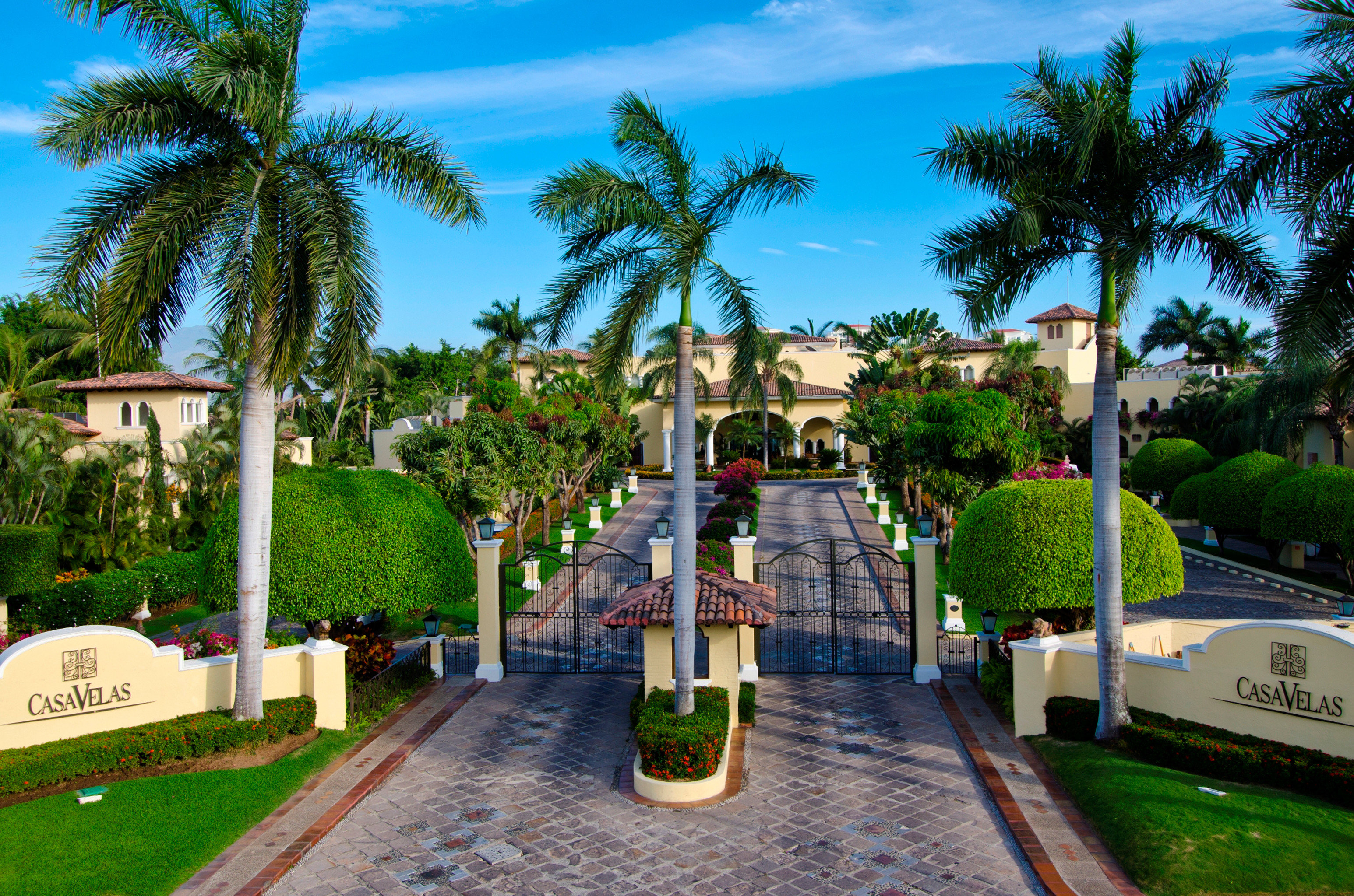 Architecture Boutique Buildings Exterior Tropical tree sky palm Resort walkway swimming pool arecales plant Garden waterway park lined
