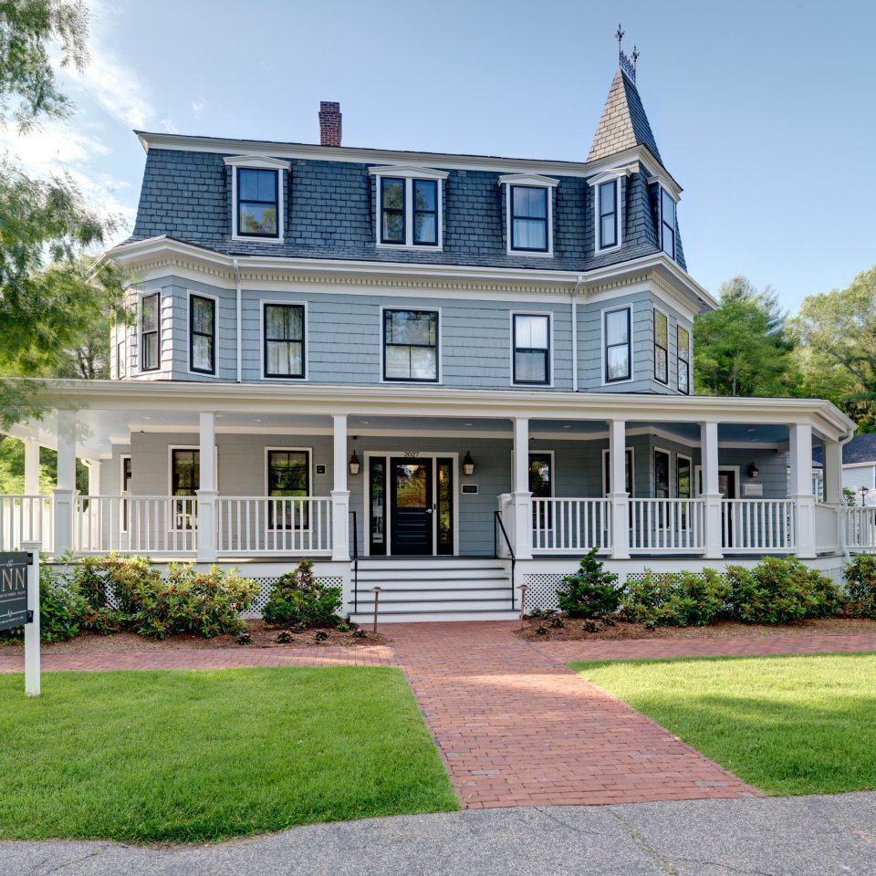 Boutique Classic Exterior Hotels Inn grass sky building tree house home residential area property mansion neighbourhood suburb Architecture siding historic house porch lawn cottage backyard manor house farmhouse Villa yard condominium old stone residential Garden