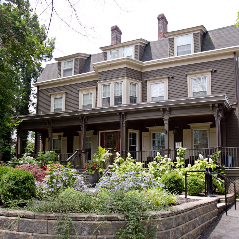Boutique Exterior Historic Inn tree building property house home neighbourhood residential area Architecture Courtyard mansion condominium stone Villa cottage Garden Resort plant