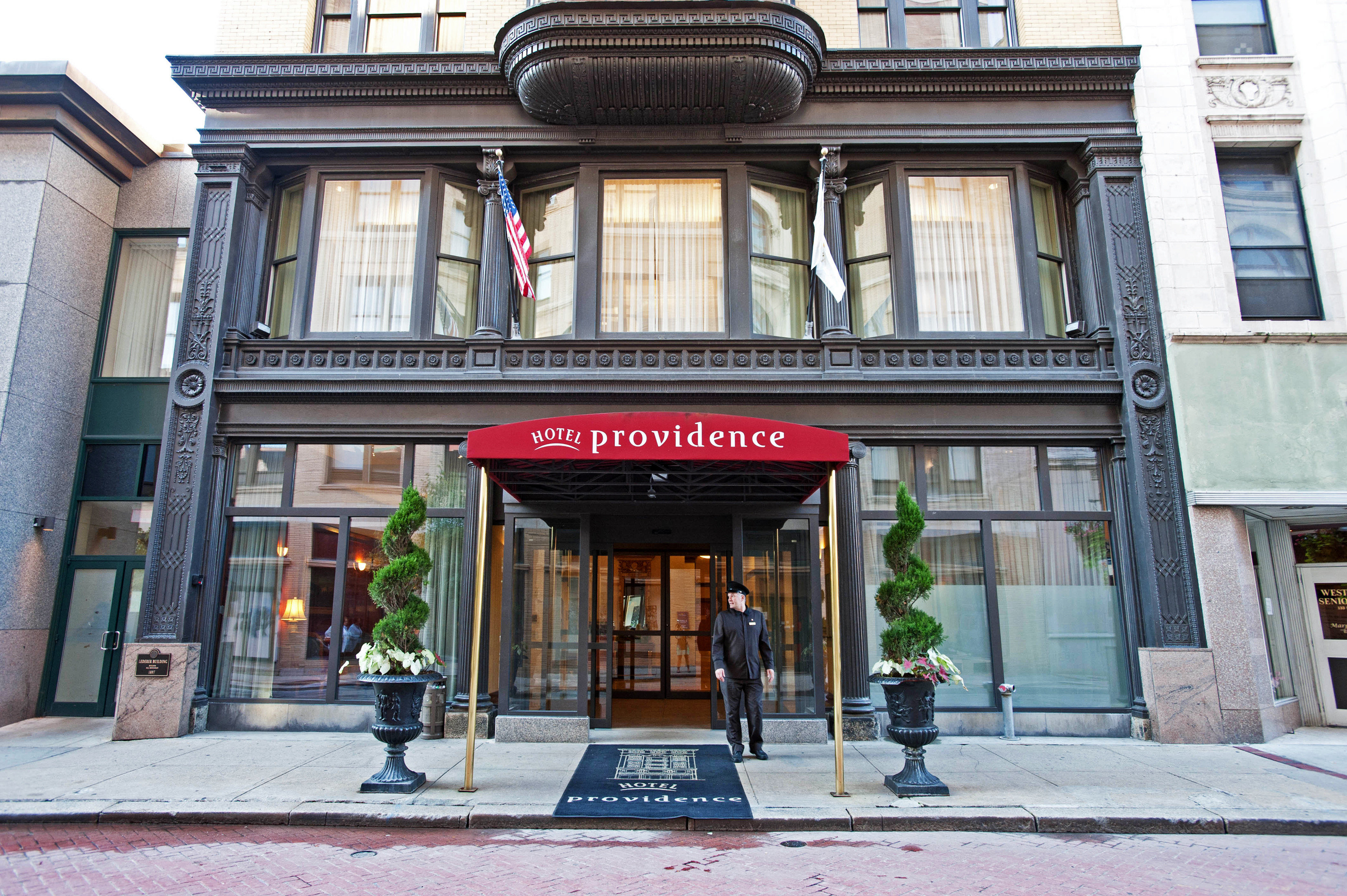Boutique Exterior Historic building Town neighbourhood street Architecture sidewalk Downtown plaza curb stone
