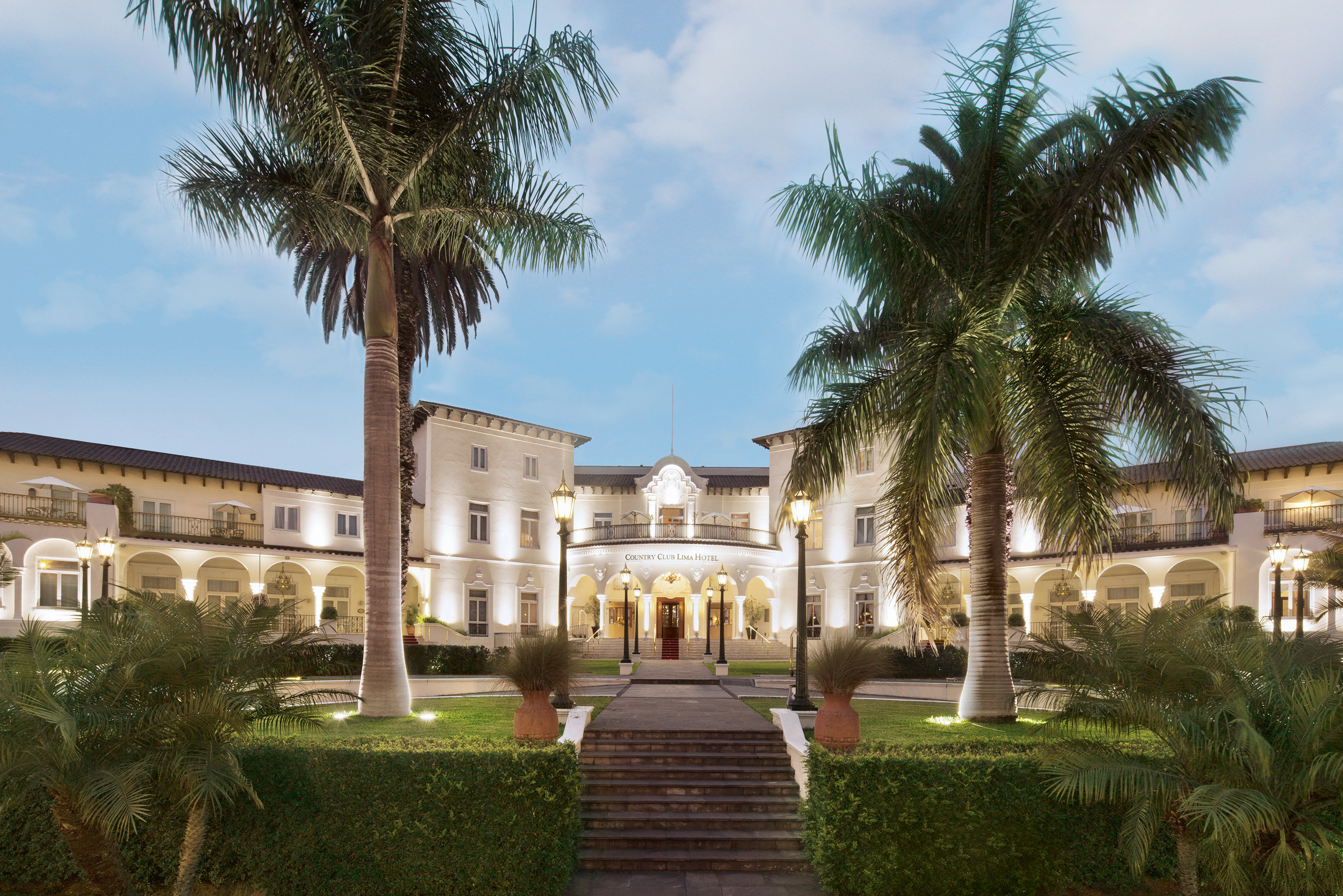 Architecture Boutique Hotels Buildings Exterior Hotels Resort Romance sky tree grass property plant building palace palm arecales plaza mansion home hacienda Villa Courtyard Garden