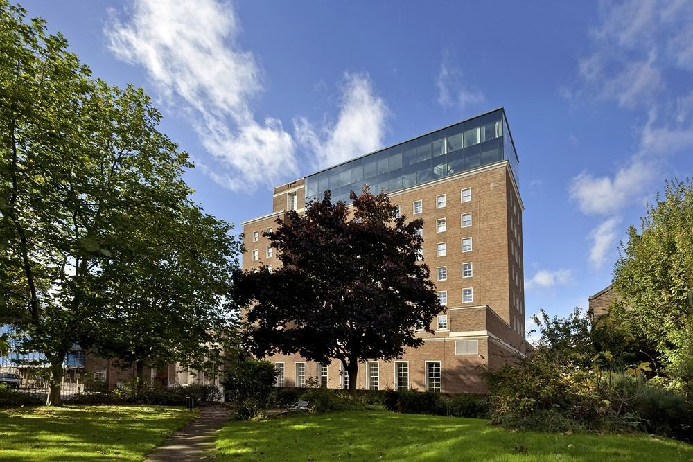 tree grass sky landmark building neighbourhood Architecture house residential area home campus tower block university lush