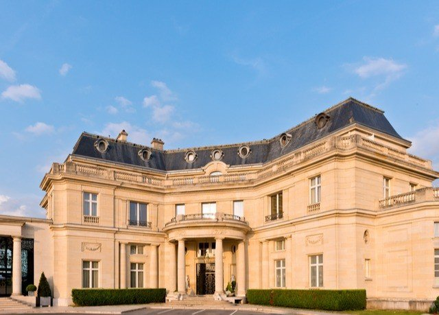 sky building property landmark palace classical architecture stately home Architecture mansion home government building tourist attraction opera house